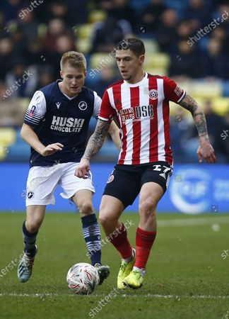 L-R Billy Mitchell of Millwall and Muhamed Besic of Sheffield United during The Emirates FA Cup Fourth Round between Millwall and Sheffield United at The Den , London, England on 25 20. (Photo by AFS/Espa-Images)