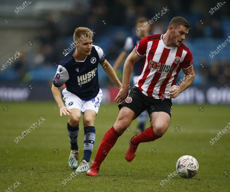 Stock Picture of L-R Billy Mitchell of Millwall and Jack O'Connell of Sheffield United.during The Emirates FA Cup Fourth Round between Millwall and Sheffield United at The Den , London, England on 25 20. (Photo by AFS/Espa-Images)