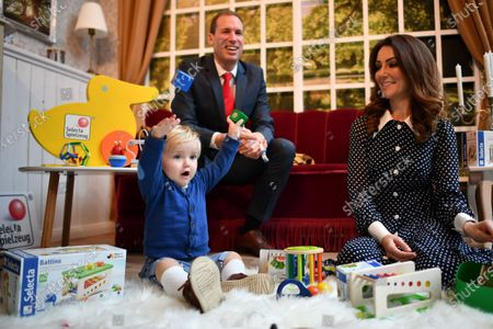 Stock Image of One-year-old Leo, Tom Moore and Heidi Agan pose as lookalikes of the Duke and Duchess of Cambridge and their son George during the 2020 International Toy Fair Press Preview in Nuremberg, Germany, 28 January 2020. The exhibition is open exclusively to professional visitors from 29 January until 02 February.