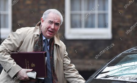 British Attorney General Geoffrey Cox departs Downing Street following a security cabinet meeting in London, Britain, 28 January 2020. The Government is set to make a statement on whether Britain is to allow Chinese company Huawei to run its 5G network.