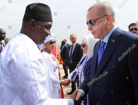 Gambia's President Adama Barrow, rleft, welcomes Turkey's President Recep Tayyip Erdogan, right, in Banjul, Gambia, . Erdogan is in Gambia on a three-nation Africa tour