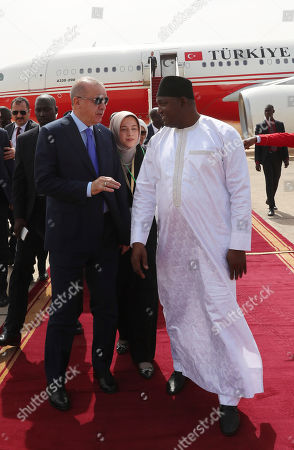 Stock Photo of Gambia's President Adama Barrow, right, welcomes Turkey's President Recep Tayyip Erdogan, left, in Banjul, Gambia, . Erdogan is in Gambia on a three-nation Africa tour