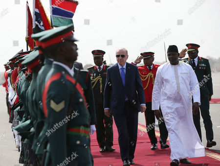 Gambia's President Adama Barrow, right, welcomes Turkey's President Recep Tayyip Erdogan, centre, in Banjul, Gambia, . Erdogan is in Gambia on a three-nation Africa tour
