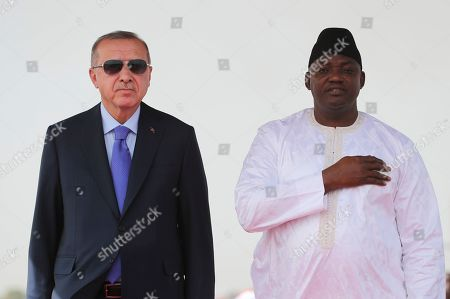 Stock Picture of Gambia's President Adama Barrow, right, welcomes Turkey's President Recep Tayyip Erdogan, left, in Banjul, Gambia, . Erdogan is in Gambia on a three-nation Africa tour