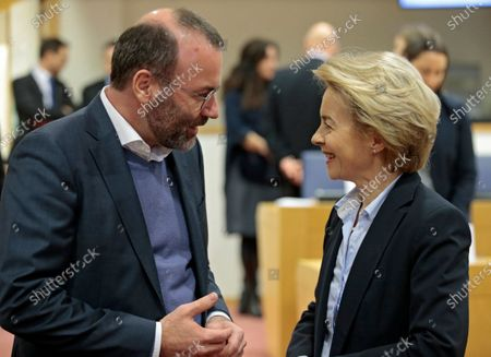 European Commission President Ursula von der Leyen (R) and Leader of the European People's Party (EPP) in the European Parliament Manfred Weber (L) attend the Conference of Presidents of the European Parliament to present the Commission's Work Programme in Brussels, Belgium, 28 January 2020.