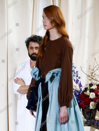 Stock Picture of Spanish designer Moises Nieto (L) watches a model presenting one of his creations during the Mercedes-Benz Fashion Week Madrid at the University of Fine Arts in Madrid, Spain, 28 January 2020. The Mercedes-Benz Fashion Week Madrid runs from 28 January to 02 February 2020.