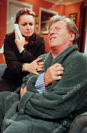 Ep 4849 Sunday 2nd July 2000 Linda is stunned when Mike suffers a heart attack in front of her. He is rushed to hospital and is told to look at the attack as an early warning. With Linda Sykes, as played by Jacqueline Pirie ; Mike Baldwin, as played by Johnny Briggs.