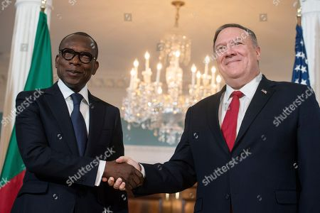 Mike Pompeo, Patrice Talon. Secretary of State Mike Pompeo, right, shakes hands with Benin President Patrice Talon at the State Department in Washington