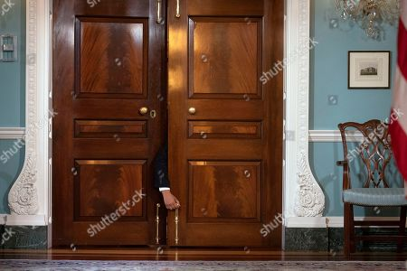 A door is unlocked so that Secretary of State Mike Pompeo and Benin President Patrice Talon can walk to a media opportunity at the State Department. in Washington