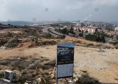 A new housing project sign stands in the Jewish West Bank settlement of Ari'el, . The population of Jewish settlements in the West Bank surged by more than 3% in 2019, well above the growth rate of Israel's overall population, a settler group said Tuesday. It predicted even higher growth this year thanks to a nascent building boom made possible by friendly policies of the Trump administration