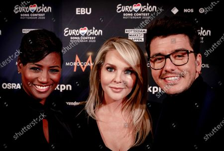 Stock Picture of Dutch singer Edsilia Rombley, Dutch actress and television presenter Chantal Janzen, and Dutch singer Jan Smit attend the Host City Insignia Exchange and the official Allocation Draw for the semi-finals of the 65th annual Eurovision Song Contest (ESC) at the city hall in Rotterdam, The Netherlands, 28 January 2020. The event announced in which of the two semifinals the participating countries will be classified. The ESC 2020 will take place at the Rotterdam Ahoy and consist of two semi-finals, to be held on 12 and 14 May 2020, and a grand final on 16 May 2020. Musicians representing 41 countries will participate in the contest.