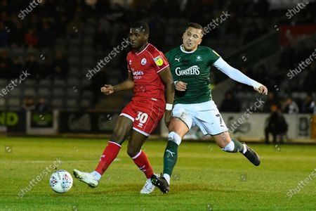 Bez Lubala (30) of Crawley Town battles for possession with Antoni Sarcevic (7) of Plymouth Argyle during the EFL Sky Bet League 2 match between Plymouth Argyle and Crawley Town at Home Park, Plymouth