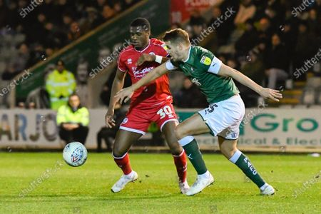 Bez Lubala (30) of Crawley Town battles for possession with Scott Wootton (5) of Plymouth Argyle during the EFL Sky Bet League 2 match between Plymouth Argyle and Crawley Town at Home Park, Plymouth