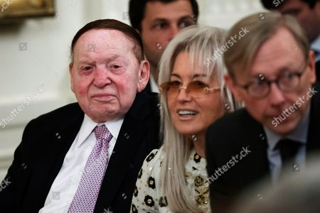Sheldon Adelson, Miriam Adelson, Brian Hook. Sheldon Adelson, left, with his wife Miriam Adelson, are seated and Brian Hook, U.S. special representative for Iran, before an event with President Donald Trump and Israeli Prime Minister Benjamin Netanyahu in the East Room of the White House in Washington, to announce the Trump administration's much-anticipated plan to resolve the Israeli-Palestinian conflict