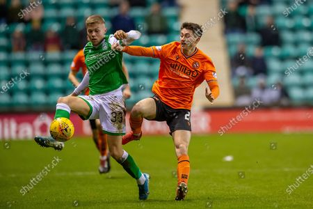 Declan Glass (#21) of Dundee United FC tackles Fraser Murray (#33) of Hibernian FC during the William Hill Scottish Cup fourth round match between Hibernian FC and Dundee United FC at Easter Road Stadium, Edinburgh