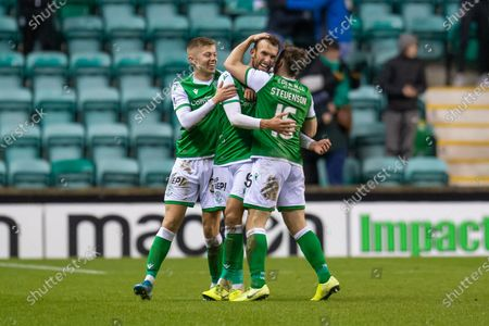 Christian Doidge (#9) of Hibernian FC scores his third goal and runs away to celebrate with Fraser Murray (#33) and Lewis Stevenson (#16) of Hibernian FC during the William Hill Scottish Cup fourth round match between Hibernian FC and Dundee United FC at Easter Road Stadium, Edinburgh