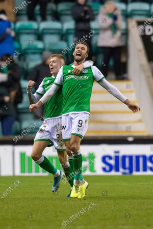 Christian Doidge (#9) of Hibernian FC scores his third goal and runs away to celebrate with Fraser Murray (#33) of Hibernian FC during the William Hill Scottish Cup fourth round match between Hibernian FC and Dundee United FC at Easter Road Stadium, Edinburgh