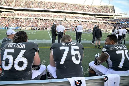 LPGA Diamond Resorts Tournament of Champions. AFC guard Quenton Nelson (56), of the Indianapolis Colts, guard Joel Bitonio (75), of the Cleveland Browns, and offensive tackle Ronnie Stanley (79), of the Baltimore Ravens, chat during the second half of the NFL Pro Bowl football game against the NFC in Orlando, Fla