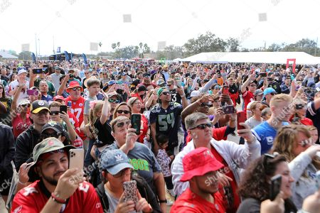 Fans watch Flo Rida perform before the NFL Pro Bowl football game, in Orlando, Fla