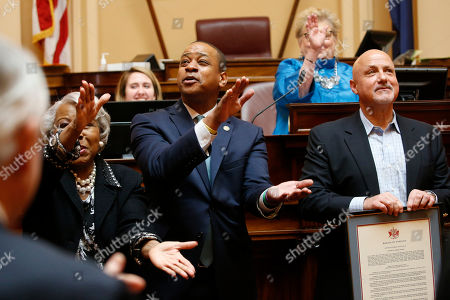 Justin Fairfax, Louise Lucas, Mike Rizzo. Virginia Lt. Gov. Justin Fairfax, center, along with State Sen. Louise Lucas, D-Portsmouth, left, do the Washington Nationals Baby Shark song as Nationals president and General Manager, Mike Rizzo, right, looks on as the Virginia Senate honors the team during the session at the Capitol, in Richmond, Va