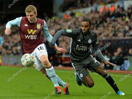 Matt Targett (L) of Aston Villa in action against Ricardo Pereira of Leicester during the Carabao Cup semi final second leg match between Aston Villa and Leicester City in Birmingham, Britain, 28 January 2020.