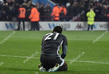 Leicester's Ricardo Pereira sits on the ground after the end of the English League Cup semifinal 2nd leg soccer match between Aston Villa and Leicester City and at the Villa'Park in Birmingham, England, . Aston Villa won the game 2-1, and advance to the final