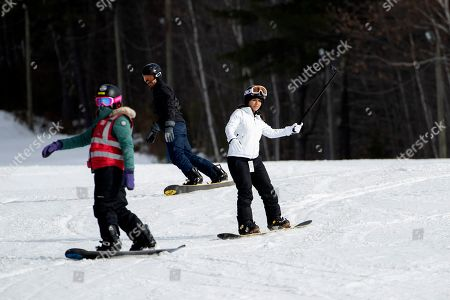 Democratic presidential candidate Rep. Tulsi Gabbard, D-Hawaii, snowboards with supporters and staff at Cranmore Mountain Resort, in North Conway, N.H