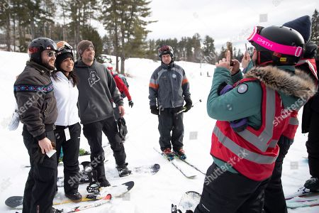 Democratic presidential candidate Rep. Tulsi Gabbard, D-Hawaii, second from left, takes a photo with supporters and staff while snowboarding at Cranmore Mountain Resort, in North Conway, N.H