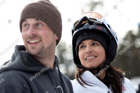Democratic presidential candidate Rep. Tulsi Gabbard, D-Hawaii, right, smiles as she talks to supporters and staff while snowboarding at Cranmore Mountain Resort, in North Conway, N.H