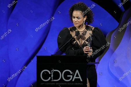"""Stock Photo of Nathalie Emmanuel accepting on behalf of Michele Clapton - Excellence in Sci-Fi/Fantasy Television - 'Game of Thrones: """"The Iron Throne""""'"""