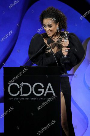 """Stock Image of Nathalie Emmanuel accepting on behalf of Michele Clapton - Excellence in Sci-Fi/Fantasy Television - 'Game of Thrones: """"The Iron Throne""""'"""