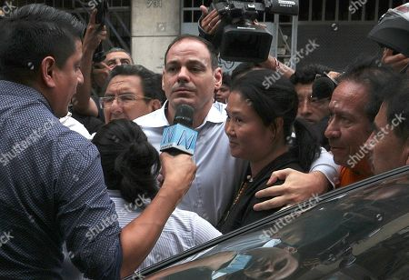 Keiko Fujimori, the daughter of Peru's former President Alberto Fujimori and opposition leader with her husband Mark Vito Villanela, enters to the courtroom in handcuffs in Lima, Peru, . In a court session a judge decided she must return to preventive detention pending a corruption investigation