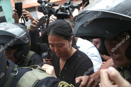 Keiko Fujimori, the daughter of Peru's former President Alberto Fujimori and opposition leader is escorted by police in Lima, Peru, . In a court session a judge decided she must return to preventive detention pending a corruption investigation
