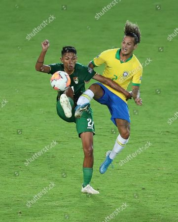 Hector Sanchez, Guga. Bolivia's Hector Sanchez, left, battles for the ball with Brazil's Guga during a South America Olympic qualifying U23 soccer match at Centenario stadium in Armenia, Colombia