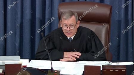 In this image from United States Senate television, Chief Justice of the United States John G Roberts Jnr, Jr. adjourns the US Senate until 1:00pm EST on Wednesday, January 29 after White House Counsel Pat Cipollone completed his final argument during the impeachment trial of US President Trump in the US Senate in the US Capitol