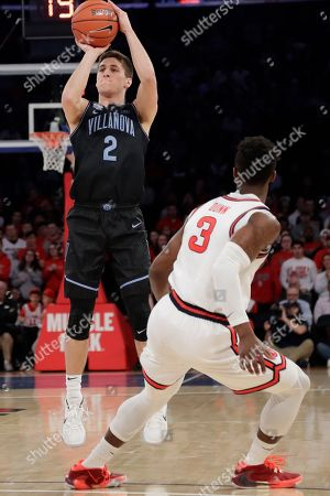 Villanova's Collin Gillespie (2) shoots over St. Johns Rasheem Dunn (3) during the first half of an NCAA college basketball game, in New York