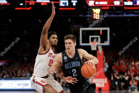 St. John's Nick Rutherford (24) defends Villanova's Collin Gillespie (2) during the first half of an NCAA college basketball game, in New York