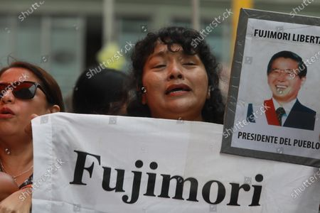 Supporters of Keiko Fujimori Higuchi wait outside of her house in San Borja, Peru, 28 January 2020, before she leaves for the courthouse to hear the decision of Judge Victor Zuniga Urday from the Fourth National Preparatory Investigation Court of the Superior Specialized Court in Organized Crime and Corruption of Officials, who will decide whether to accept or reject the request for 18 months and two days of preventive detention requested by Public Prosecutor Jose Domingo Perez for alleged money laundering and obstruction of justice.