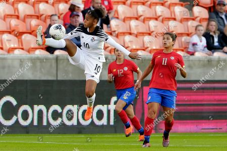 Panama midfielder Aldrith Quintero (10) jumps for the pass in front of Costa Rica defender Lixy Rodriguez (12) and forward Raquel Rodriguez (11) during the first half of a women's Olympic qualifying soccer match, in Houston