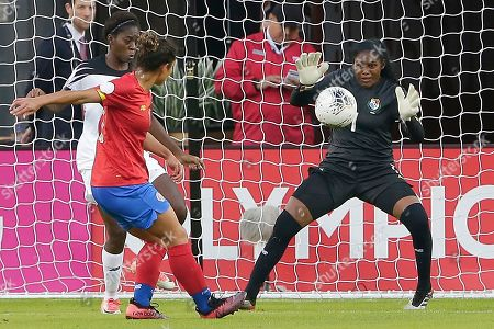 Costa Rica forward Raquel Rodriguez, middle, tries to score as Panama Goalkeeper Yenith Bailey (1) blocks the shot as Panama defender Maria Murillo, left, looks on during the first half of a women's Olympic qualifying soccer match, in Houston