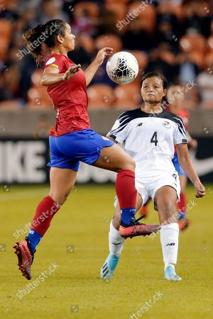 Costa Rica forward Raquel Rodriguez, left, brings down the ball in front of Panama defender Hilary Jaen (4) during the second half of a women's Olympic qualifying soccer match, in Houston