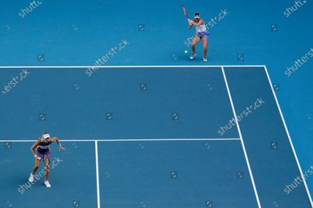 Stock Image of Timea Babos of Hungary and Kristina Mladenovic of France in action during their women's doubles quarterfinal match against Hao-Ching and Latisha Chan of Taipei at the Australian Open Grand Slam tennis tournament in Melbourne, Australia, 29 January 2020.