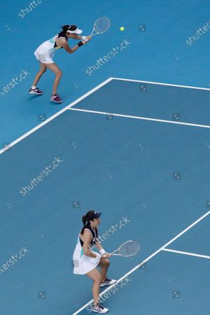 Stock Picture of Hao-Ching Chan (L) and Latisha Chan (R) of Taipei in action during their women's doubles quarterfinal match against Timea Babos of Hungary and Kristina Mladenovic of France at the Australian Open Grand Slam tennis tournament in Melbourne, Australia, 29 January 2020.