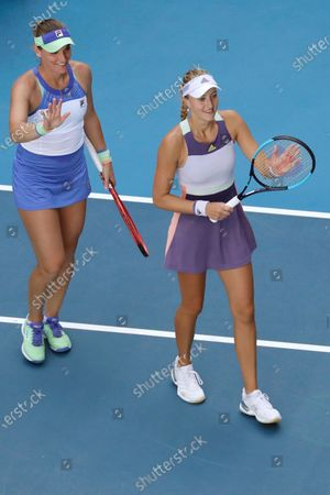 Timea Babos (L) of Hungary and Kristina Mladenovic (R) of France in action during their women's doubles quarterfinal match against Hao-Ching and Latisha Chan of Taipei at the Australian Open Grand Slam tennis tournament in Melbourne, Australia, 29 January 2020.
