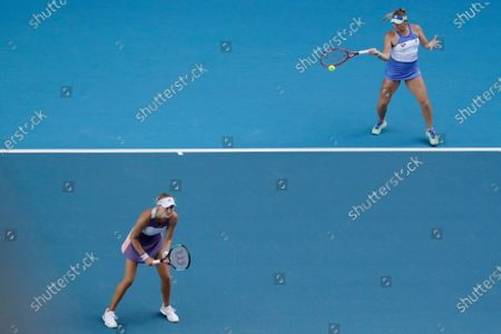 Timea Babos (R) of Hungary and Kristina Mladenovic (L) of France in action during their women's doubles quarterfinal match against Hao-Ching and Latisha Chan of Taipei at the Australian Open Grand Slam tennis tournament in Melbourne, Australia, 29 January 2020.