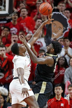 Shaq Carter, Trevion Williams. Rutgers forward Shaq Carter (13) defends against Purdue forward Trevion Williams (50) as Williams looks to pass during the second half of an NCAA college basketball game, in Piscataway, N.J