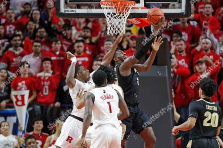 Shaq Carter, Trevion Williams, Akwasi Yeboah, Nojel Eastern. Purdue forward Trevion Williams tries to get a shot off with Rutgers forward Shaq Carter, left, defending, while Rutgers forward Akwasi Yeboah (1) and Purdue guard Nojel Eastern (20) watch during the second half of an NCAA college basketball game, in Piscataway, N.J