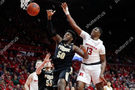 Trevion Williams, Shaq Carter. Purdue forward Trevion Williams (50) and Rutgers forward Shaq Carter (13) go after a rebound during the second half of an NCAA college basketball game, in Piscataway, N.J