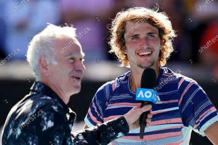 Alexander Zverev (R) of Germany is interviewed by former tennis player John McEnroe (L) after defeating Stan Wawrinka of Switzerland at the conclusion of their men's singles quarter-final match at the Australian Open tennis tournament at Melbourne Park in Melbourne, Australia, 29 January 2020.