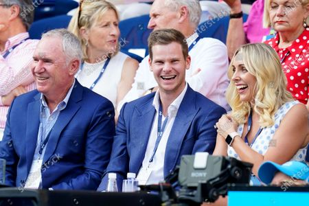 Former Australian cricketer Allan Border (L), Australian cricketer Steve Smith (C), and his wife Dani (R) attend the quarter final match between Rafael Nadal of Spain and Dominic Thiem of Austria at the Australian Open Grand Slam tennis tournament at Rod Laver Arena in Melbourne, Australia, 29 January 2020.